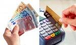 Los españoles pagan con dinero en efectivo y después con tarjeta