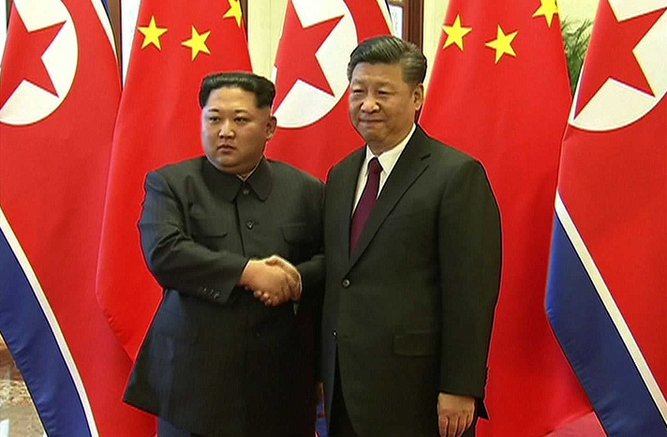 Kim Yong Un y Xi Jinping