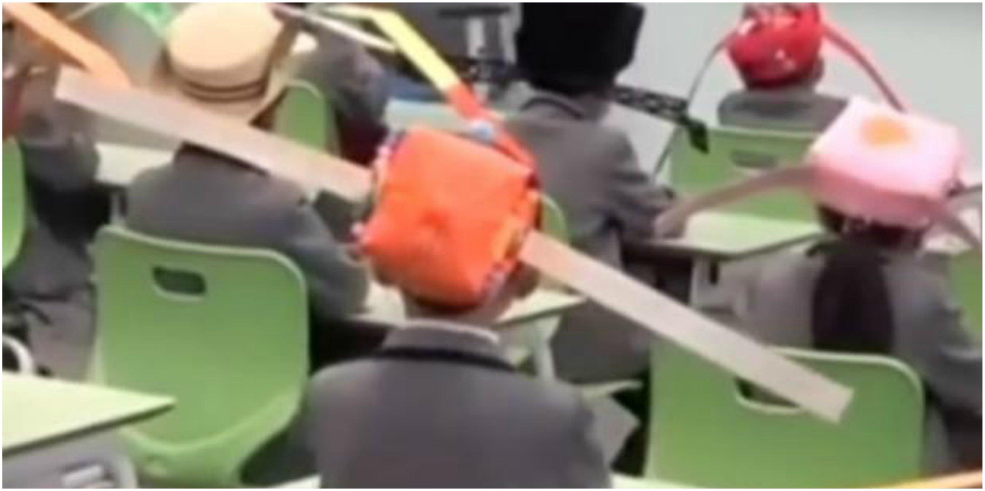 Desescalada 'made in china'. Sombreros de un metro de ancho para mantener la distancia social en las escuelas